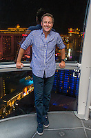 """LAS VEGAS, NV - AUGUST 3:   ***HOUSE COVERAGE*** Chris Harrison, host of popular American romance/reality series """"The Bachelor,"""" """"The Bachelorette"""",  """"Bachelor in Paradise"""" and """"Who Wants To Be A Millionaire,"""" pictured 550 feet above Las Vegas on the High Roller observation wheel at The LINQ Promenade in Las Vegas, Nevada on August 3, 2016. Credit: Erik Kabik Photography/ MediaPunch"""