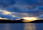 Idaho, North, Coeur d'Alene. Golden sunlight beams through clouds over Lake Coeur d'Alene.