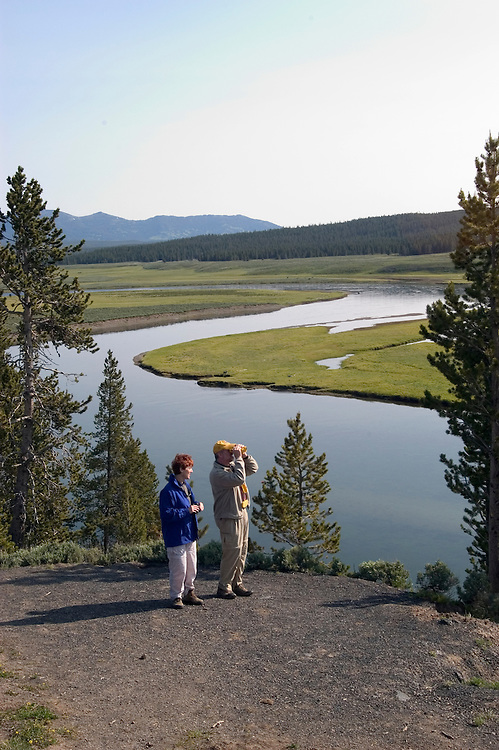 WY: Wyoming, Yellowstone National Park:.Couple at Grizzly Overlook in Hayden Valley..Model Released..Photo #: yellow1087..Photo copyright Lee Foster, 510/549-2202, lee@fostertravel.com, www.fostertravel.com..
