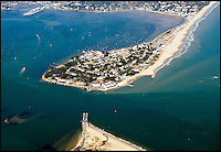 BNPS.co.uk (01202 558833)<br /> Pic: Peter Willows<br /> <br /> Sandbanks peninsula in Poole, Dorset<br /> <br /> A humble holiday home a family bought for just &pound;1,000 almost a century ago on the exclusive enclave of Sandbanks has turned into a luxury property now worth &pound;5 million.<br /> <br /> The bungalow was bought new by Dr Edward Andreae in the 1920s when the practice of building on the sandy Dorset peninsula was questioned because of perceived issues over stability.<br /> <br /> Over the last seven decades the bolthole has been passed down through the generations of the same family until it fell into a state if disrepair.<br /> <br /> In 2011 Dr Andreae's great-grandson, Tim Baldwin, and his father Jonathan, made the drastic decision to demolish the 90 year old building and erect a new one in its place.<br /> <br /> They spent 580,000 pounds creating a luxurious beach escape on the 'Millionaires' Row' in Poole Harbour.<br /> <br /> The plot is now home to a sprawling seven bedroom, five bathroom property which experts believe to be worth around five million pounds - 5,000 times it's original purchase price.