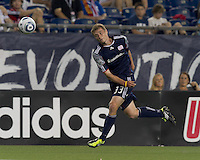 New England Revolution midfielder Zak Boggs (33) heads the ball. In a Major League Soccer (MLS) match, the New England Revolution tied Houston Dynamo, 1-1, at Gillette Stadium on August 17, 2011.