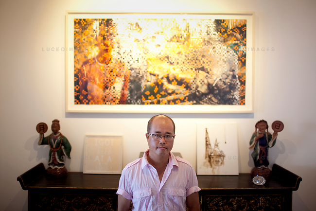 "An untitled piece from the series, ""From Vietnam to Hollywood"" by Dinh Q. Le hangs in his Ho Chi Minh City home...Dinh Q. Le is a Vietnamese American fine arts photographer best known for his woven-photographs. Le uses traditional weaving techniques to combine mournful images from the Vietnam War with a sort of colorful fantasy. Le now works from his home in Ho Chi Minh City, Vietnam."