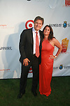 Dr. Mehmet and Lisa Oz attend Russell Simmons' 12th Annual Art for Life East Hampton Benefit, NY 7/30/11