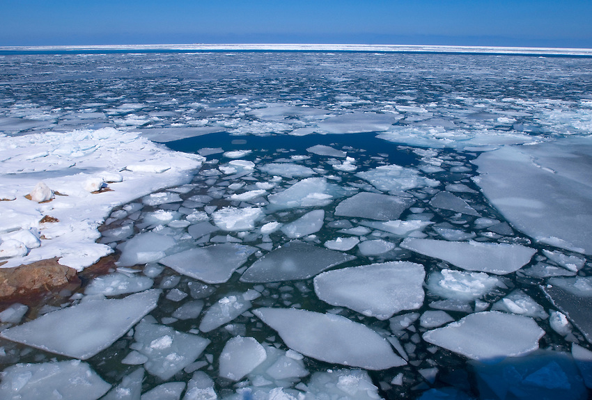 Pieces of ice float on Lake Superior as seen from Little Presque Isle near Marquette, Michigan.