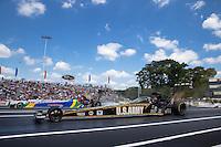Jun. 2, 2013; Englishtown, NJ, USA: NHRA top fuel dragster driver Tony Schumacher (near lane) races alongside Sidnei Frigo during the Summer Nationals at Raceway Park. Mandatory Credit: Mark J. Rebilas-