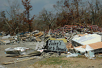 Judy's Dirt to Diamnond's sign in the rubble of Waveland Mississippi days after Hurricane Katrina devasted this community.