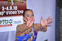 """Daria Dmitrieva of Russia waves to camera from """"kiss & cry"""" during event finals at 2010 Holon Grand Prix at Holon, Israel on September 4, 2010.  (Photo by Tom Theobald)"""