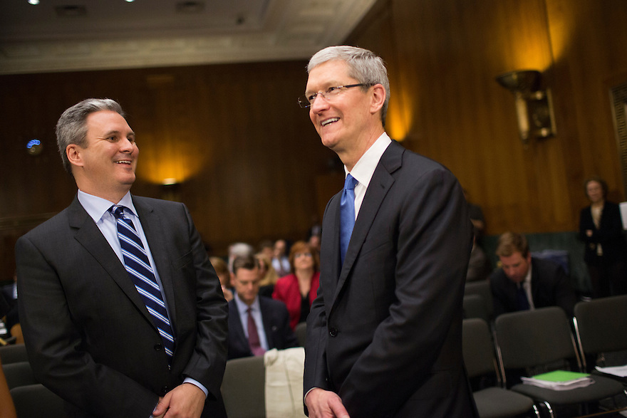 Apple CEO Tim Cook speaks with Steve Dowling, Director of Corporate Public Relations at Apple,    during a break in his testimony  at a Senate homeland security and governmental affairs investigations subcommittee hearing on offshore profit shifting and the U.S. tax code, on Capitol Hill in Washington.  Cook defended the company's tax record during a Senate hearing where lawmakers said the maker of iPads, iPods and Mac computers kept billions of dollars in profits in Irish subsidiaries to avoid U.S. taxes.