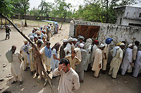 Men from Swat and Buner districts try to register for shelter at one of the nearby UNHCR refugee camps. The Pakistani government began an offensive against the Taliban in the Swat Valley in April 2009, which led to a major humanitarian crisis. Up to two million civilians were estimated to have been displaced by the fighting.
