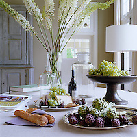 An indoor picnic laid on the dining room table; the fresh, wholesome and simple ingredients serve as a metaphor for the design of the barn itself