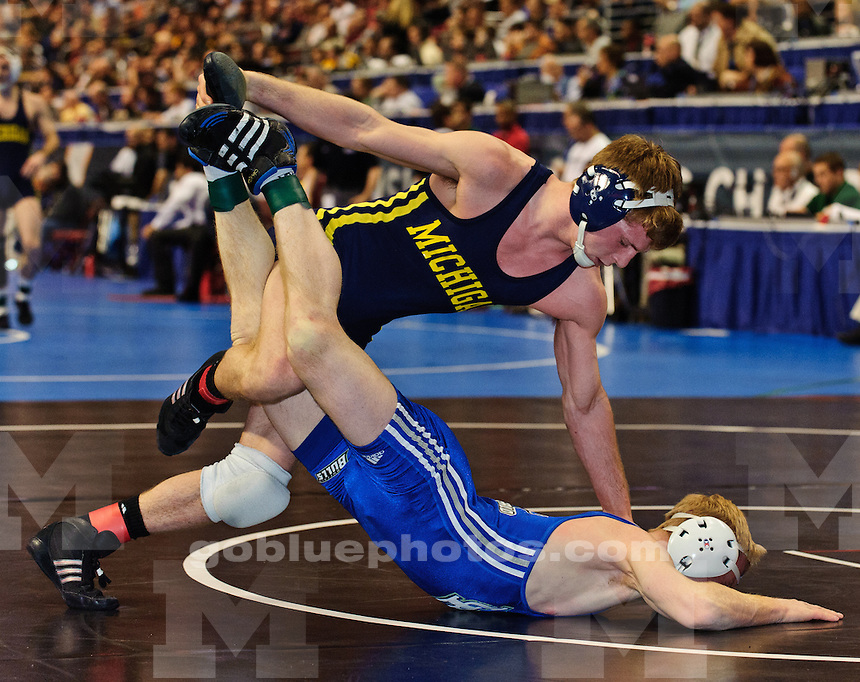 Michigan wrestler Zac Stevens (122 lbs) wins by decision over Kevin Smith (Buffalo) 8-0 in the fourth wrestleback round of the 2011 NCAA Wrestling Championships.