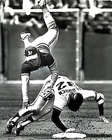 Oakland A's 2nd baseman Mike Gallego is upended by Dan Gladden. (April 5,1986 photo by Ron Riesterer/<br />