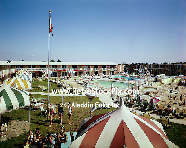 Courtyard of the Country Squire Motel in Cherry Hill, NJ. Huge colorful umbrellas and interesting lamp post around the pool. 1960's