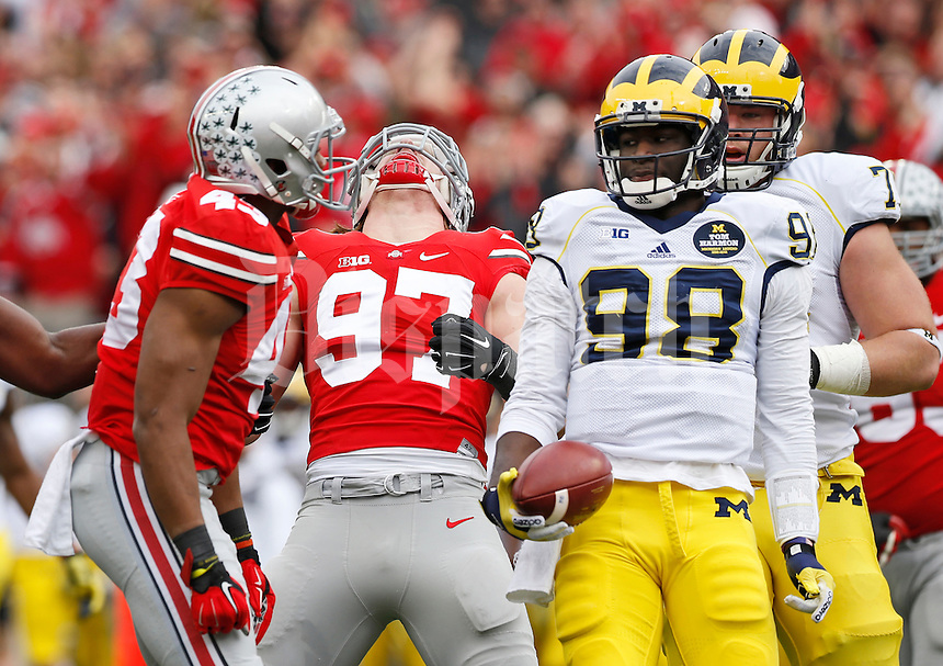 Ohio State Buckeyes defensive lineman Joey Bosa (97) yells after linebacker Darron Lee (43) sacked Michigan Wolverines quarterback Devin Gardner (98) during the 1st quarter of the NCAA football game at Ohio Stadium on Nov. 29, 2014. (Adam Cairns / The Columbus Dispatch)