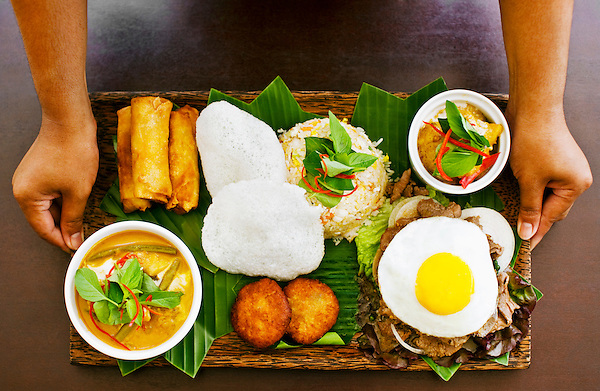 The Khmer tasting platter at FCC Angkor Kitchen, FCC Angkor hotel, Siem Reap, Cambodia. The Khmer platter features a sampling of Cambodian specialties like fish cakes, spring rolls, fish amok, curry, fried rice, and beef lok lok with egg. March 3, 2009.