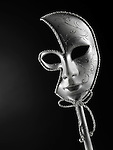 Beautiful silver Venetian mask isolated on black background