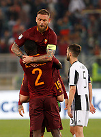 Calcio, Serie A: Roma vs Juventus. Roma, stadio Olimpico, 14 maggio 2017. <br /> Roma&rsquo;s Daniele De Rossi, top, hugs his teammate Antonio Ruediger as Juventus&rsquo; Miralem Pjanic, right, leaves the pitch at the end of the Italian Serie A football match between Roma and Juventus at Rome's Olympic stadium, 14 May 2017. Roma won 3-1.<br /> UPDATE IMAGES PRESS/Riccardo De Luca