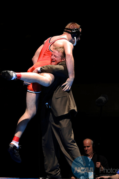 12 MAR 2011: The Wartburg assistant coach Mark Adkins celebrates Mark Corsello's victory in the 285 lbs championship during the Division III Men's Wrestling Championship held at the La Crosse Center in La Crosse Wisconsin. Stephen Nowland/NCAA Photos