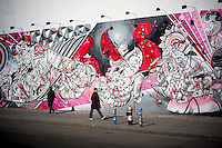 A mural by the artists, twin brothers HOW and NOSM is seen at the corner of Bowery and Houston Street in New York on Sunday, February 17, 2013. The space is famous for hosting murals by graffiti artists, most notably Keith Haring . (© Richard B. Levine)