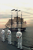 "Boston, MA - July 21, 1997 - Sailors on board the destroyer USS Ramage (DDG 61) man the rails while escorting USS Constitution the worlds oldest commissioned war ship underway in Massachusetts Bay, MA.  Over head the Navy's ""Blue Angels"" Flight Demonstration Squadron conducts a fly-over salute.  Commissioned on October 21st, 1797, Constitution set sail unassisted for the first time in 116 years.  Constitution will celebrates her 200th birthday on October 21st of this year after completing a 40 month overhaul.  .Credit: John E. Gay - U.S. Navy via CNP"