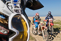 Motorcycle riders on beach in Baja, Mexico
