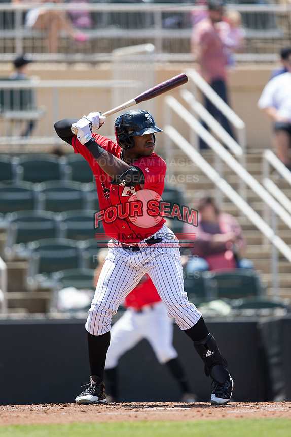 Micker Adolfo (27) of the Kannapolis Intimidators at bat against the Asheville Tourists at Kannapolis Intimidators Stadium on May 7, 2017 in Kannapolis, North Carolina.  The Tourists defeated the Intimidators 4-1.  (Brian Westerholt/Four Seam Images)