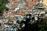 Houses seen on a steep hillside in the favela of Rocinha, Rio de Janeiro, Rio de Janeiro, Brazil, 20 February 2012. Rocinha, the largest shanty town in Brazil and one of the most developed in Latin America, has its own samba school called GRES Academicos da Rocinha. The Rocinha samba school is very loyal to its neighborhood. Throughout the year, the entire community actively participate in rehearsals, culture events and parades related to the carnival.
