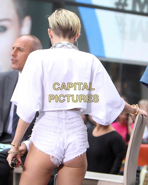 Miley Cyrus <br /> Performs at NBC's Today Show Concert Series at Rockefeller Plaza in New York City, NY., USA.<br /> October 7th, 2013<br /> on stage in concert live gig performance performing music half length white shirt jean denim cut off shorts back behind rear<br /> CAP/MPI/RW<br /> &copy;RW/ MediaPunch/Capital Pictures