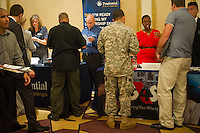 Job seekers attend a job fair for military veterans in midtown in New York on Thursday, September 13, 2012.  The US Labor Department reports new claims for unemployment benefits for August 2102 rose near to a two-month high.  Tropical Storm Isaac is cited as being a contributing factor. ( © Frances M. Roberts)