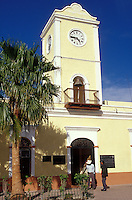 Two men chatting in front of theMunicipal Hall in the town of San Jose del Cabo, Baja California Sur, Mexico