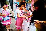 Retail workers hand out promotional products during a sale in Myeondong, a popular shopping district in Seoul, South Korea.