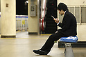 Apr. 30, 2010 - Tokyo, Japan - A Japanese businessman uses his mobile phone on April 30, 2010 in Tokyo, Japan. Japan's unemployment rate rose to 5.0 % in March, up 0.1 percent from the previous month, the Health, Labor and Welfare Ministry said in a report on Friday. The number of jobless people rose 150,000 from a year earlier to 3.5 million, the ministry said.