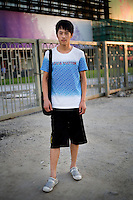 Liuduanyi, a student, age 21, poses for a portrait in Beijing. Response to 'What does China mean to you?': 'An enormous spirit from the oceans to the rivers.'  Response to 'What is your role in China's future?': 'A businessman.'