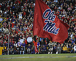 Ole Miss cheerleader carries a flag vs. LSU at Tiger Stadium in Baton Rouge, La. on Saturday, November 17, 2012. LSU won 41-35.....
