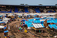 Survivors of the Zamboanga City rebel attack take refuge in the city's largest stadium in Zamboanga, Mindanao, The Philippines on November 4, 2013. These Internally Displaced People (IDP) have set up shared tents along the running track and in the breachers in this stadium after surviving the 3 week long attack by MNLF rebels. Photo by Suzanne Lee for SPRINT-IPPF