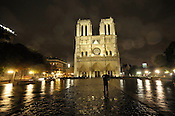 A tourist takes in Notre Dame de Paris in July 2011. The Roman Catholic cathedral is considered one of the finest examples of French gothic architecture.