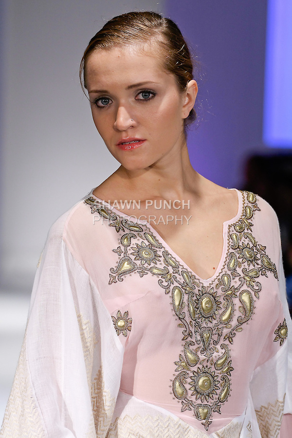 Model walks runway in an outfit from the Montaha Couture Summer 2013 collection fashion show by Montaha Alajeel, during BK Fashion Weekend Spring Summer 2013, September 28, 2012.