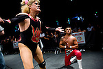 Lucha Libre AAA wrestlers Pimpinela, left, and Deccnis enact a ringside drama at a match in Sacramento, CA March 28, 2009.