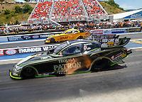 Jun 19, 2016; Bristol, TN, USA; NHRA funny car driver Alexis DeJoria (near) races alongside teammate Del Worsham during the Thunder Valley Nationals at Bristol Dragway. Mandatory Credit: Mark J. Rebilas-USA TODAY Sports