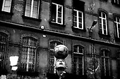 Wroclaw 20.04.2006 Poland<br /> The worst and the most dangerous district in Wroclaw ( Poland ) , called by people &quot;The Bermuda Triangle&quot;. There are walls bearing an inscription &quot;Who will enter here, will not exit alive&quot; Many families there are pathological and live in extreme poverty. Children have no place for any games so they loaf around on this wasted district and disseminate a juvenile delinquency. Many of them become sexually active though thery are only 10-12 years old<br /> (Photo by Adam Lach / Napo Images)<br /> <br /> Najbardziej nabezpieczna dzielnica we Wroclawiu zwana przez ludzi Trojkatem Bermudzkim. Sa tam sciany opatrzone napisem &quot; Kto tu wejdzie, nigdy nie wyjdzie stad zywy&quot; Mieszka tam wiele rodzin patologicznych i zyja w wielkiej nedzy. Dzieci wlocza sie po ulicach nie majac miejsc na zabawe i szerza przestepczosc wsrod nieletnich. Wiele z dzieci uprawia seks choc maja zaledwie 10-12 lat<br /> (Fot Adam Lach / Napo Images)