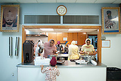 Women in the kitchen at Sikh Gurudwara of North Carolina in Durham prepare the community meal for the Vigil for the Victims of the Oak Creek Shooting on Wednesday August 8th 2012.