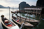 Longtail fishing boats are moored at the Muslim fishing village of Ko Panyi.  The village of 2000 inhabitants are believed to be descended from seafaring families who arrived from Java over 200 years ago.  Ko Panyi, Phang-Nga, THAILAND