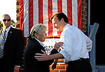"East Meadow, NY - OCTOBER 15: Congresswoman Carolyn McCarthy (D) and Nassau County Executive Thomas Suozzi (D) speaking closely with each other, with part of large American flag and ""New York for Obama  Biden"" poster behind them, and Secret Service agent at side, during Obama Rally at Eisenhower Park at dusk October 15, 2008 in East Meadow, New York, less than 2 miles away from Hofstra University, the site of final presidential debate held later that night."