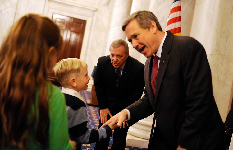 "UNITED STATES - OCTOBER 06:  Sen. Mark Kirk, R-Ill., right, and Senate Majority Whip Richard Durbin, D-Ill., greet visitors from Illinois in the Russell Caucus Room during an ""Illinois Constituent Coffee.""  The meetings are held weekly when the Senate is in session.  (Photo By Tom Williams/Roll Call)"