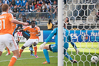Freddy Adu (11) of the Philadelphia Union shoots and scores on Houston Dynamo goalkeeper Tally Hall (1) during the first half during a Major League Soccer (MLS) match at PPL Park in Chester, PA, on September 23, 2012.
