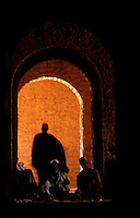 During noon prayers in Bani, Burkina Faso, devout Muslim men gather in the cool air of an adobe mosque.
