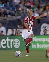 Chivas USA midfielder Simon Elliott (9) passes the ball. In a Major League Soccer (MLS) match, Chivas USA defeated the New England Revolution, 3-2, at Gillette Stadium on August 6, 2011.
