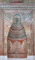 Mihrab decorated with frescoes in the Et'hem Bey Mosque or Xhamia e Et'hem Beut, begun 1789 by Molla Bey and finished in 1823 by his son Haxhi Ethem Bey, great-grandson of Sulejman Pasha, Tirana, Albania. The frescoes decorating the mosque, unusual in Islamic art, use swirling vegetal patterns and the mihrab indicates the direction of Mecca. The mosque is listed as a Cultural Monument of Albania. Tirana was founded by the Ottomans in 1614 by Sulejman Bargjini and became the capital of Albania in 1920. Picture by Manuel Cohen