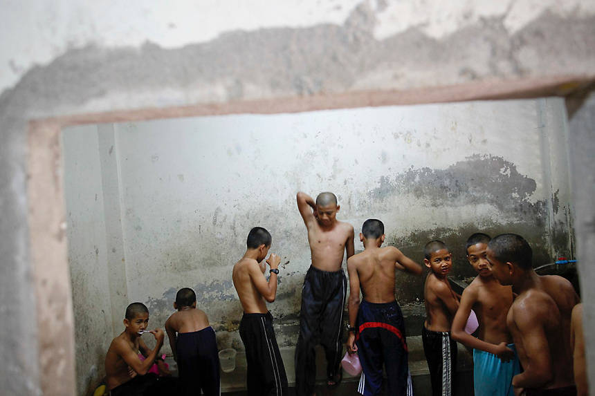 Muslim boys wash themselves before praying at an Islamic school where they live and study Koran in the village of Lam Mai in the troubled Yala province March 1, 2011. Yala is one of three Muslim-dominated provinces bordering Malaysia where more than 4,300 people, both Muslims and Buddhists, have been killed in a low-level insurgency since 2004.   REUTERS/Damir Sagolj (THAILAND)