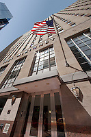 Stock photo of 1001 McKinney building face with American flag blowing
